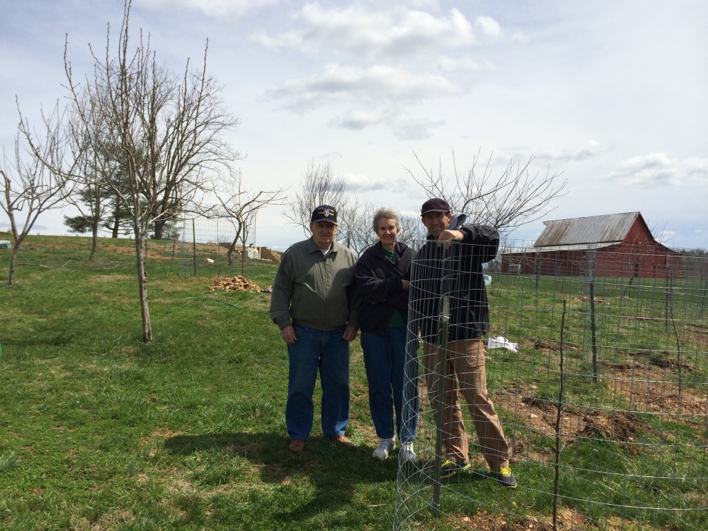 Uncle Sonny, my Mom, and brother Mark help put up the final cages